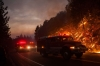 Fire trucks drive along Highway 120 during the fight against the Rim Fire near Buck Meadows, Calif., on Saturday.