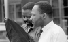 The Rev. Martin Luther King Jr., right, and his close associate, Rev. Ralph Abernathy, are released after 8 days from a jail in Birmingham, Ala., on April 20, 1963.