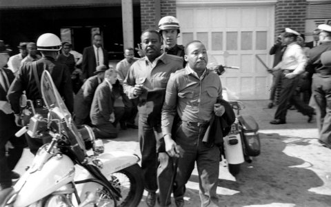 "Rev. Ralph Abernathy, left, and Rev. Martin Luther King Jr., right are taken by a policeman as they led a line of demonstrators into the business section of Birmingham, Ala., on April 12, 1963. During his stay in jail, King would pen ""Letter From Birmingham Jail,"" arguably the raison d'être of the civil rights movement."