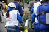 Staff of the Colombian Red Cross assist a riot police officer wounded during clashes with protesters.