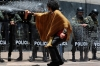 A demonstrator sprays foam at riot police during a march in Bogota on Thursday.