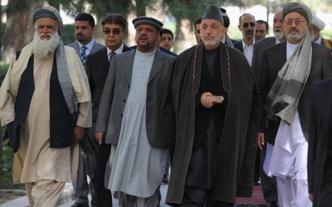 Afghan President Hamid Karzai (second from right) and Abdul Rab Rasoul Sayaf, a former warlord with a controversial past, at the Presidential Palace in Kabul