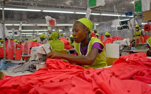 Factory workers sew garments at the Caracol Industrial Park complex. Former Secretary of State Hillary Clinton presided over the $300 million park's opening in 2012