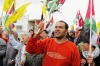 Bassem Abu Rahmah was a non-violent protester against the Israeli presence in and around his West Bank village. Here, he is pictured in 2009 at the front of a protest march just weeks before his death.