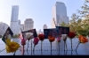 Flowers and pictures are left along the North Pool at the 9/11 Memorial in New York City during ceremonies for the 12th anniversary of the terrorist attacks.