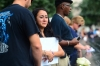 Mercedes Arias listens as the name of her father, Joseph Amatuccio, is read at the 9/11 Memorial during ceremonies for the 12th anniversary of the terrorist attacks.