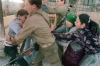 <b>Ramallah, 1988.</b> A Palestinian mother and elder sister try to stop an Israeli soldier from taking away a Palestinian boy arrested for rock throwing. The First Intifada ended in 1993, when the Oslo peace accords were signed.