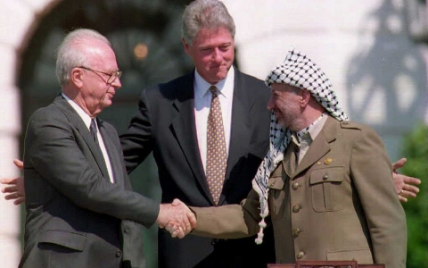 Yasser Arafat and Yitzhak Rabin shake hands to mark the start of the Oslo Accords on Sept. 13, 1003
