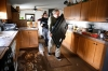 Don DeGraff and his niece Julie DeGraff, carry valuable items out of their home in La Salle, Colo. on Saturday.