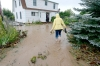 Hanna Hinseth walks through ankle deep water to get to her home to inspect the extent of damage after severe flooding in Boulder.