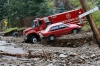 A Jamestown, Colo. Volunteer Fire Department truck lies stuck in mud and debris Saturday.
