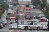 Police and firefighters respond to the report of shooting at the Navy Yard in Washington, D.C., Monday.