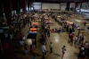 People affected by Hurricane Ingrid and Tropical Storm Manuel in Acapulco attend to shelter centers established by the SEDENA and SEMAR on Wednesday.