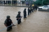 Members of the Mexican navy secure a flooded area to prevent looting.