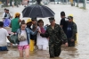 Tourists wade through a flooded street in Acapulco, Guerrero state.