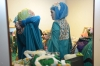 Contestants of the Muslimah World pageant prepare backstage for the grand final of the contest in Jakarta.