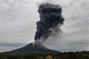 A massive ash cloud rises from the crater of the Mount Sinabung volcano during a fresh eruption on Tuesday.