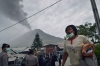 Indonesian police evacuate residents of Karo district from the erupting Mount Sinabung volcano.