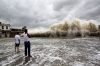 People watch waves hit shore as Typhoon Usagi approaches Shantou in Guangdong province.