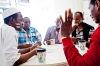 Somalis play dominoes at a Somali-owned cafe and in Fort Morgan, August 13, 2013. Many Somali refugees have moved to the town in recent years, lured by the possibility of decent jobs at Cargill's local meat-packing plant that require very little language skills.