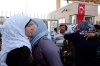 Syrian refugees greet each other at the Turkish Cilvegozu gate border with Syria, Friday, Aug. 30, 2013.