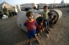 Syrian-Kurdish refugee children sit in a concrete block at the Quru Gusik refugee camp, near Arbil, Iraq, on Tuesday.