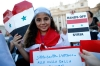 A child from Syria holds up a heart-shaped Syrian flag before a prayer led by Pope Francis calling for peace in Syria.