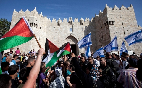 Israelis and Palestinians wave flags to celebrate Jerusalem Day on May 8, 2013
