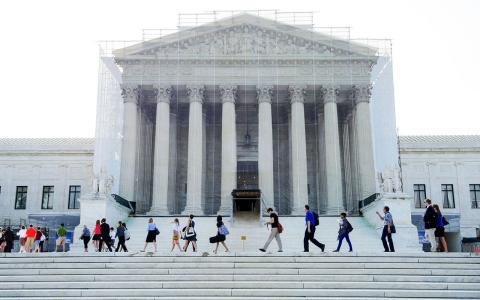 People walk past the Supreme Court in Washington, D.C.