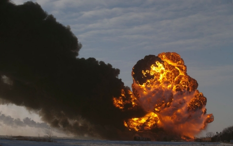 A fire breaks out at the site of an oil train derailment in Casselton, N.D. on Dec. 30, 2013.
