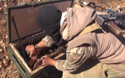 Thumbnail image for ISIL fighters show off weapons likely seized from US airdrop