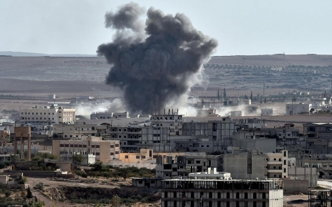 Smoke rises from an airstrike in the Syrian town of Ain al-Arab, known as Kobane by the Kurds, as seen from the Turkish-Syrian border.