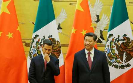 Mexico president pushes trade ties in China while protests rage at home