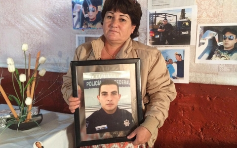 Araceli Rodriguez holds a photo of her son Luis Angel Leon.