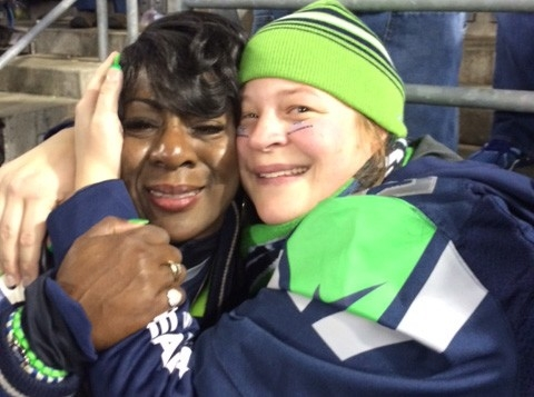 Seahawks fan Jill Borchers (at right) hugs Beverly Sherman, the mother of cornerback Richard Sherman.