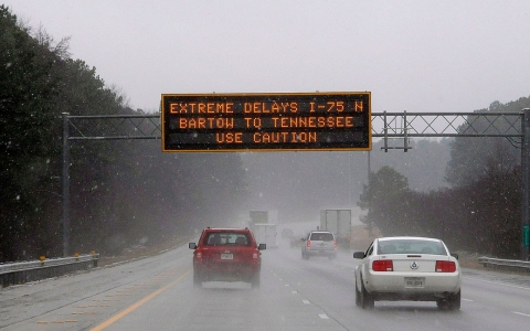 A transportation sign warns motorists on Interstate 7 in Kennesaw, Ga., about 20 miles north of metro Atlanta, on Feb. 11, 2014.
