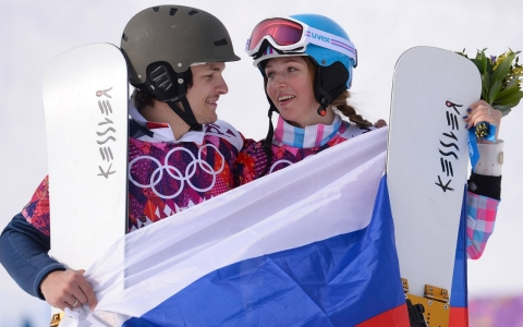 Gold medalist Vic Wild, wrapped in the Russian flag with his wife Alena Zavarzina, who won a bronze medal.