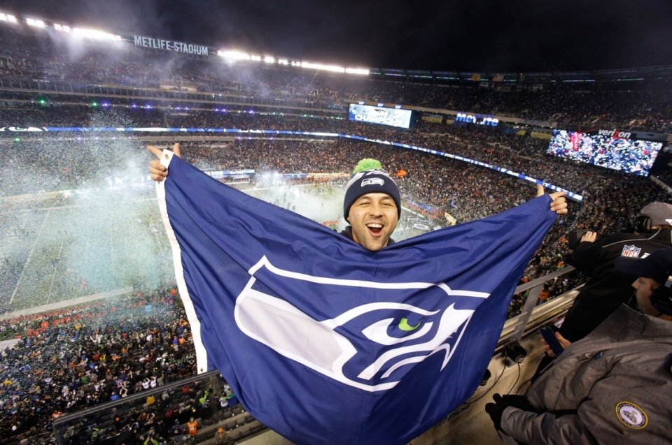 A Seattle Seahawks Fan Celebrates After His Team Won The Championship Game Mel Evans AP