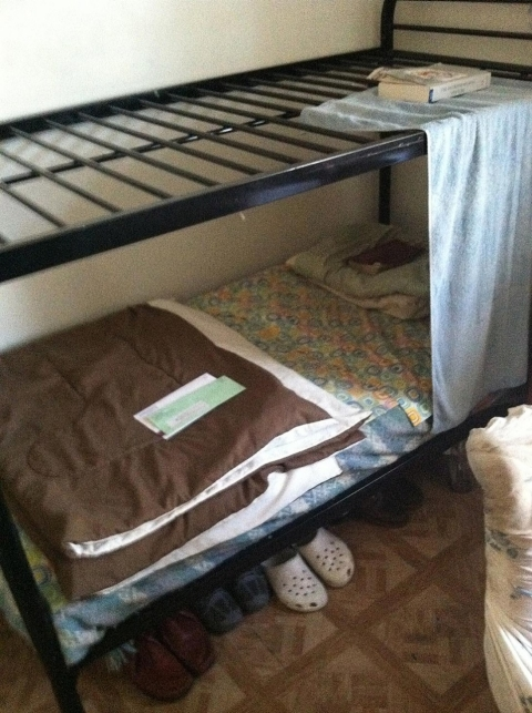 a bed in Uplifting Men II, a now defunct Three-Quarter House in East New York, Brooklyn.
