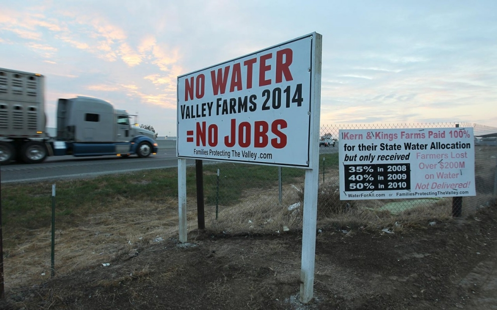 a sign near state highway 99 that calls for water and drought management