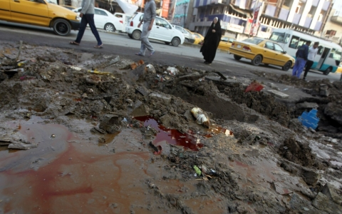 Mud and blood lie on the road in the aftermath of an explosion in Baghdad Wednesday.