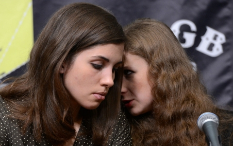 Nadezhda Tolokonnikova (L) and Maria Alekhina (R), members of Russian punk group Pussy Riot attend a press conference Wednesday in New York City.