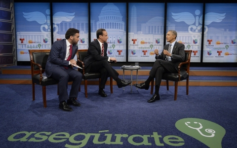 President Obama speaks with television hosts Enrique Acevedo (left) and Jose Diaz Balart (center) about the Affordable Care Act.