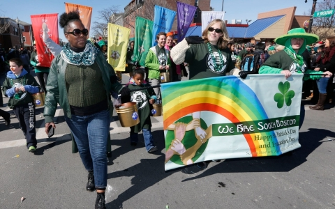 A group standing for diversity marches in the annual St. Patrick's Day parade in the South Boston on March 16, 2014.