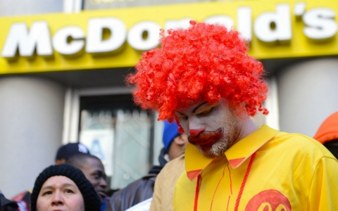 Fast-food workers calling for better wages demonstrate outside a McDonald's restaurant in NYC, NY, Tuesday.