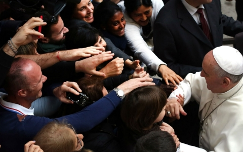 Pope Francis greets faithful as he arrives for prayer vigil with relatives of the Mafia's victims Friday in Rome, Italy.