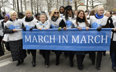 Protesters march from the United Nations Friday in honor of International Women's Day.