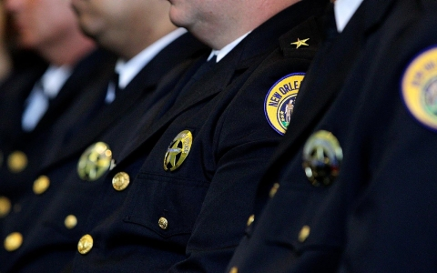 Members of the NOPD listen as Attorney General Eric Holder discusses the consent decree on July 24, 2012.