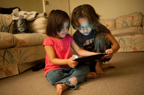 Kids reading ipad
