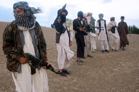 This file photo taken on September 26, 2008 shows fighters with Afghanistan's Taliban militia standing on a hillside at Maydan Shahr in Wardak province, west of Kabul.